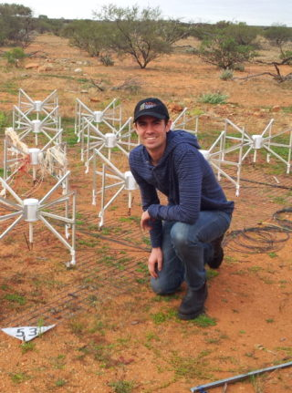 Dr Benjamin McKinley during a trip to the Murchison Widefield Array telescope in outback Western Australia. The 16 metal 'spiders' form a single antenna 'tile', of which there are 256, spread out across an area of around 6 km in diameter. Dr McKinley and the team are using this radio telescope to observe the Moon in their search for radio signals from the early Universe.